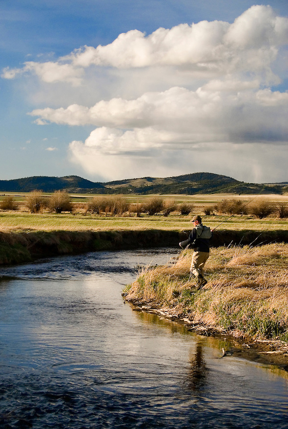 A fisherman casts beneath a big sky on the Smith River in central Montana.