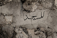 "An Arabic handwriting is seen on a wall with the word ""Mosque""  marking the entrance of what use to be the Mosque of the village, on the ruins of  Lifta, a Palestinian village in the outskirts of Jerusalem, whose Palestinian inhabitants fled in 1948. The village, the last standing Palestinian village of its kind, is about to be turned into a luxury Israeli neighborhood,  Photo by Quique Kierszenbaum"