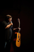 A guitar player prepares to perform during the 20th year of the Tosco Music Party, held at the Overcash Academic and Performing Arts Center Dale F. Halton Theater Central Piedmont Community College. The annual event, named after John Tosco, owner of the Tosco Music Studio, is designed to showcase professional and amateur musicians.