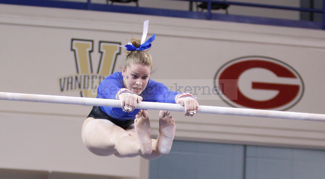 Freshman Sara Shipley performs on the uneven bars in the University of Kentucky gymnastics meet against the University of Alabama, in Memorial Coliseum, on Friday, Feb. 10, 2012. Photo by Latara Appleby | Staff ..