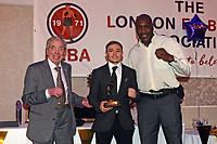 Sunny Edwards (C) receives the Johnny Kent Trophy for best London prospect from Peter Kent (L) and Derek Williams during the London Ex-Boxers Association Awards Lunch at the Grand Connaught Rooms on 16th February 2020