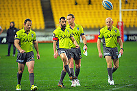 The match officials walk off after the Telstra Premiership NRL match between the NZ Warriors and St George Illawarra Dragons at Westpac Stadium, Wellington, New Zealand on Saturday, 8 August 2015. Photo: Dave Lintott / lintottphoto.co.nz