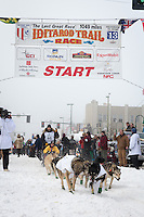 Richie Diehl and team leave the ceremonial start line at 4th Avenue and D street in downtown Anchorage during the 2013 Iditarod race. Photo by Jim R. Kohl/IditarodPhotos.com