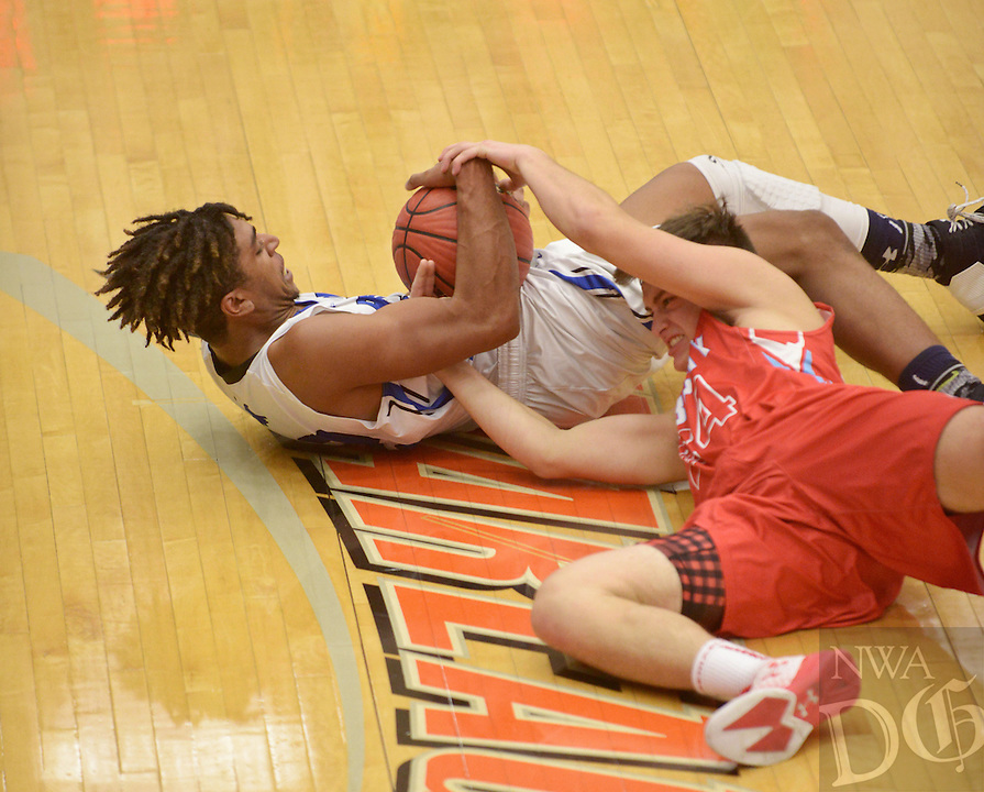 NWA Democrat-Gazette/BEN GOFF @NWABENGOFF<br /> Tony Casey of Rogers and Colton Carpenter (24) of Webb City (Mo.) dive for a loose ball on Thursday Dec. 8, 2016 during the Arvest Hoopfest basketball tournament at War Eagle Arena in Rogers.