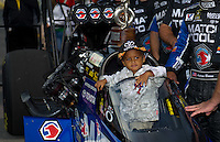 Sept. 5, 2011; Claremont, IN, USA: Adler Brown , son of NHRA top fuel dragster driver Antron Brown in winner circle after winning the US Nationals at Lucas Oil Raceway. Mandatory Credit: Mark J. Rebilas-