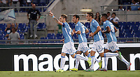Calcio, Serie A: Lazio vs Bologna. Roma, stadio Olimpico, 22 agosto 2015.<br /> Lazio&rsquo;s Lucas Biglia, left, celebrates with teammates, from second left, Stefan Radu, Stefan De Vrij and Ricardo Kishna after scoring during the Italian Serie A football match between Lazio and Bologna at Rome's Olympic stadium, 22 August 2015.<br /> UPDATE IMAGES PRESS/Isabella Bonotto