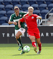 Chicago Red Star midfielder Carli Lloyd (10) battles for the ball with Washington Freedom midfielder Lori Lindsey (6).  The Washington Freedom defeated the Chicago Red Stars 3-2 at Toyota Park in Bridgeview, IL on July 26, 2009.