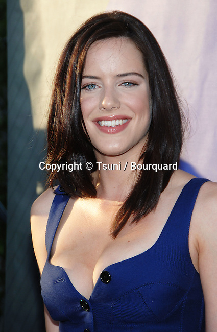 Michelle Ryan  arriving at the tca ( television critic association ) NBC Summer party on the roof of the Beverly Hilton Hotel in Los Angeles.<br /> <br /> headshot<br /> eye contact<br /> blue dress<br /> smile