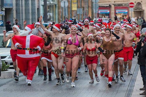 """People participate a half naked """"Santa run"""" organised the 5th time to support a charity in Budapest, Hungary on December 09, 2012. ATTILA VOLGYI"""