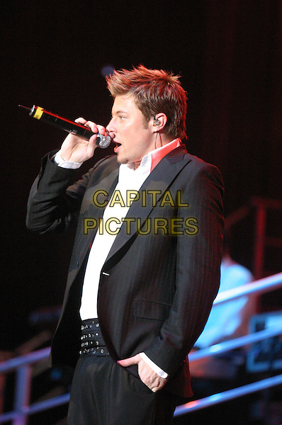 DUNCAN JAMES - BLUE.Perform live in concert at Nottingham Arena,.UK June 28th 2005..half length stage gig music .Ref: JEZ.www.capitalpictures.com.sales@capitalpictures.com.©Jez Self/Capital Pictures
