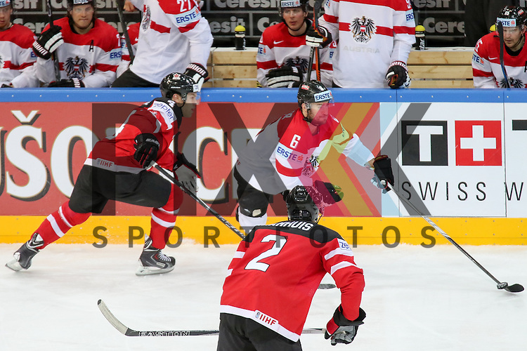 Oestereichs Rotter, Rafael (Nr.6) behaupten den Puck im Spiel IIHF WC15 Kanada vs. Oestereich.<br /> <br /> Foto &copy; P-I-X.org *** Foto ist honorarpflichtig! *** Auf Anfrage in hoeherer Qualitaet/Aufloesung. Belegexemplar erbeten. Veroeffentlichung ausschliesslich fuer journalistisch-publizistische Zwecke. For editorial use only.