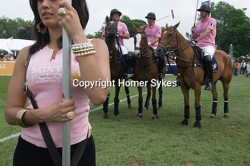 Mint Polo in the Park. Hurlingham Park Fulham London Uk June 6th 2010. Cheerleader IG Index Team Paris playing in  pink.