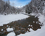 Okanogan National Forest, WA<br /> Lost river flowing through a snowy forest with peaks of the Cascade range in the distance, Methow Valley
