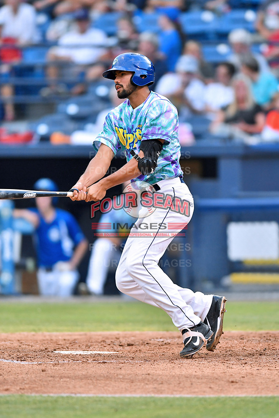 Asheville Hippies first baseman Jacob Bosiokovic (21) swings at a pitch during a game against the Greenville Drive at McCormick Field on June 29, 2017 in Asheville, North Carolina. The Drive defeated the Tourists 9-6. (Tony Farlow/Four Seam Images)