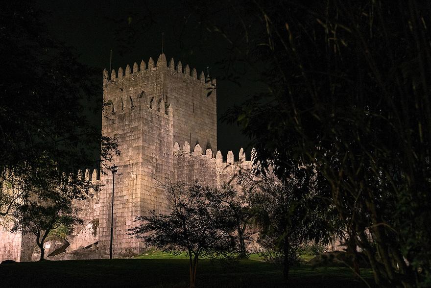 Castelo de São Miguel rises from a hilltop above Guimarães, Portugal.
