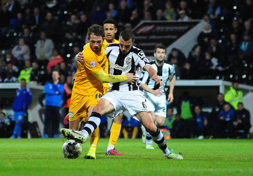 Preston North End's Joe Garner vies for possession with Notts County's Haydn Hollis<br /> <br /> Photographer Chris Vaughan/CameraSport<br /> <br /> Football - The Football League Sky Bet League One - Notts County v Preston North End - Tuesday 21st April 2015 - Meadow Lane - Nottingham<br /> <br /> &copy; CameraSport - 43 Linden Ave. Countesthorpe. Leicester. England. LE8 5PG - Tel: +44 (0) 116 277 4147 - admin@camerasport.com - www.camerasport.com