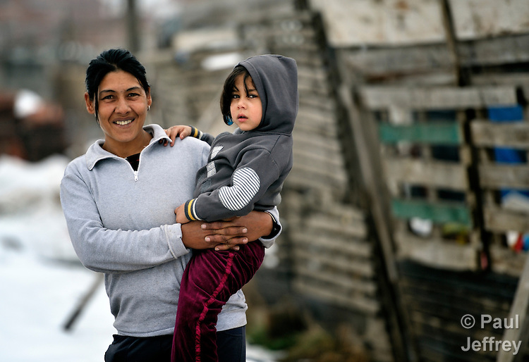 A Roma mother and child in the Zemun Polje neighborhood of Belgrade, Serbia. Many families in this neighborhood are refugees from Kosovo. Lacking legal status in Serbia, many have difficulty obtaining formal employment and accessing government services.