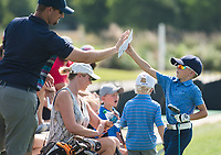 NWA Democrat-Gazette/CHARLIE KAIJO Ryan Chiles of Rogers (from left) high fives Jack Chiles, 8 during a junior golf tournament, Sunday, June 10, 2018 at The First Tee Learning Center in Lowell.<br /><br />A joint initiative founded in 2013 by the Masters Tournament, United States Golf Association and The PGA of America, the Drive, Chip and Putt Championship is a free nationwide junior golf development competition aimed at growing the game by focusing on the three fundamental skills employed in golf.<br /><br />By tapping the creative and competitive spirit of girls and boys ages 7-15, the Drive, Chip and Putt Championship provides aspiring junior golfers an opportunity to play with their peers in qualifiers around the country. Participants who advance through local, sub-regional and regional qualifying in each age/gender category earn a place in the National Finals, which is conducted at Augusta National Golf Club the Sunday before the Masters Tournament and is broadcast live by Golf Channel.<br /><br />Over 160 boys and girls throughout Northwest Arkansas have registered to compete in local qualifier.