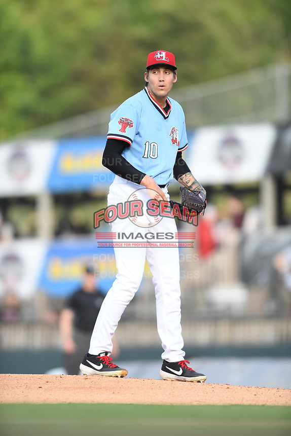 Hickory Crawdads starting pitcher Hans Crouse (10) checks the runner at third base during a game with the Asheville Tourists at L.P. Frans Stadium on May 8, 2019 in Hickory, North Carolina.The Tourists defeated the Crawdads 7-6. (Tracy Proffitt/Four Seam Images)
