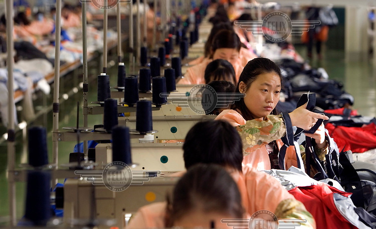 Chinese workers sewing during their shift at the Wear Company factory. Due to the shortage of skilled local workers, who often seek employment overseas, Wear Company recruits many Chinese employees. The textile business, which makes sportswear for well-known brands such as Benetton, Decathlon and Prada, is planning to increase the number of Chinese workers in their employment from 250 to about 1000. Each Chinese worker receives about 300 US dollars a month, as opposed to about the average 70 US dollars that they would earn at home.