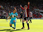 John Fleck of Sheffield Utd and Daniel Bentley of Brentford during the English Championship League match at Bramall Lane Stadium, Sheffield. Picture date: August 5th 2017. Pic credit should read: Simon Bellis/Sportimage