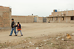 In Petrol, Peru, Ronald Fuentes, 9  and his father Jaime walk to the bus stop where he will catch a bus to La Escuela de Helen Keller in Lima.