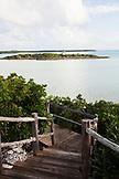 EXUMA Bahamas. A wooden path at the Fowl Cay Resort at dusk.