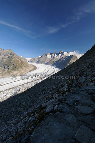Switzerland, Valais, Western Europe, Jungfrau Region, Aletsch Glacier (UNESCO world heritage site) nr. Bettmerhorn. Tourist at the start of the panorama trail.