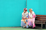 Kimono-clad 20-year-old Japanese women take a break for a smoke during a ceremony held for Coming-of-Age Day at an amusement park in Tokyo, Japan. While Japanese women can marry as early as 16 years of age and men at 18, neither is considered to reach adulthood until they reach 20, when they can also legally begin to smoke, drink and vote.