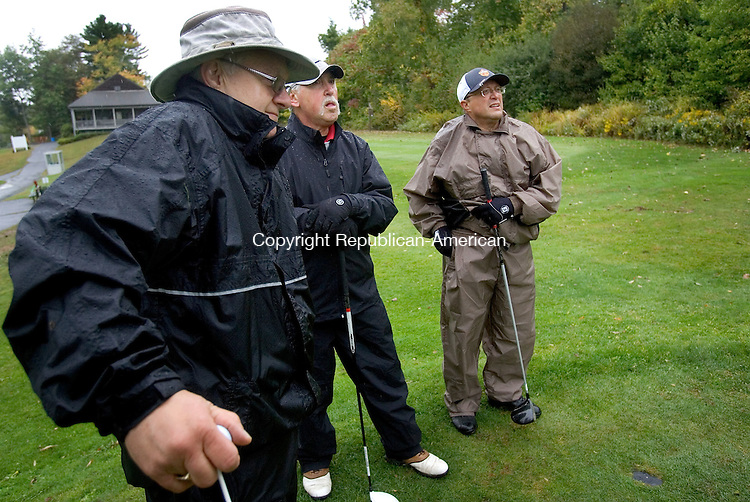 WATERTOWN CT. 02 October 2015-100215SV02-From left, Bill Wildman of Waterbury, Vin Semeraro of Prospect, and Rob Rinaldi of Waterbury wait in their rain gear to tee off at Crestwood Park Golf Course during the &ldquo;Teeing Off for the Leever Cancer Center&rdquo; golf tournament and dinner fundraiser in Watertown Friday.<br /> Steven Valenti Republican-American