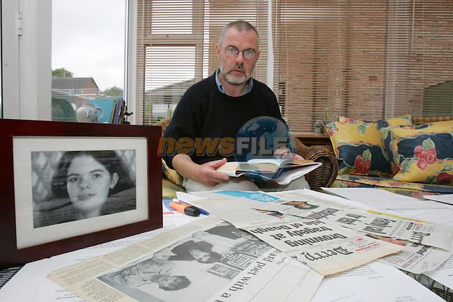 Joe Reid reading one of his late sisters poems and Mary's Picture and press cuttings on the table.Photo NEWSFILE/FRAN CAFFREY..(Photo credit should read FRAN CAFFREY/NEWSFILE)...This Picture has been sent you under the condtions enclosed by:.Newsfile Ltd..the Studio,.Millmount Abbey,.Drogheda,.Co Meath..Ireland..Tel: +353(0)41-9871240.Fax: +353(0)41-9871260.GSM: +353(0)86-2500958.email: pictures@newsfile.ie.www.newsfile.ie.FTP: 193.120.102.198..This picture is from Fran Caffrey@newsfile.ie