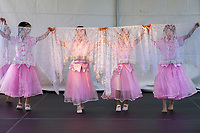 Girls wearing pink dresses performing Chinese White Vail Dance, Northwest Folklife Festival 2016, Seattle Center, Washington, USA.