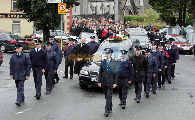 Firemen from Monaghan, Dundalk and Crossmaglen in Northern Ireland flank the the remains of Anthony Holland and Siobhan McConnon both from Carrickmacross Co. Monaghan who were buried in the St. Joseph's cemetery Carrickmacross yesterday. They were killed in a horrific traffic accident near Mullingar on Friday last..Photo Fran Caffrey Newsfile.ie..This Picture has been sent to you by Newsfile Ltd..The Studio,.Millmount Abbey,.Drogheda,.Co. Meath,.Ireland..Tel: +353(0)41-9871240.Fax: +353(0)41-9871260.ISDN: +353(0)41-9871010.www.newsfile.ie..general email: pictures@newsfile.ie