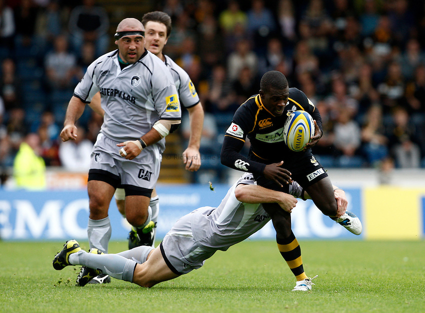Photo: Richard Lane/Richard Lane Photography. London Wasps v Leicester Tigers. 11/09/2011. Wasps' Christian Wade is tackled by Tigers' Scott Hamilton.