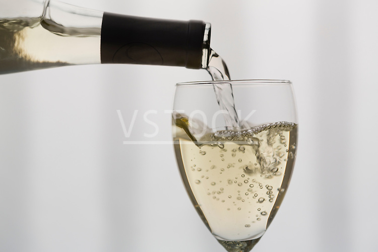 White wine pouring into wineglass