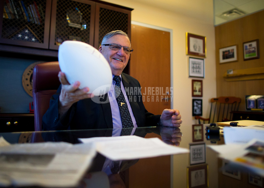 Jan 21, 2015; Phoenix, AZ, USA; Maricopa County sheriff Joe Arpaio with his NFL football autographed by Dallas Cowboys quarterback Tono Romo in his office in downtown Phoenix. Mandatory Credit: Mark J. Rebilas-