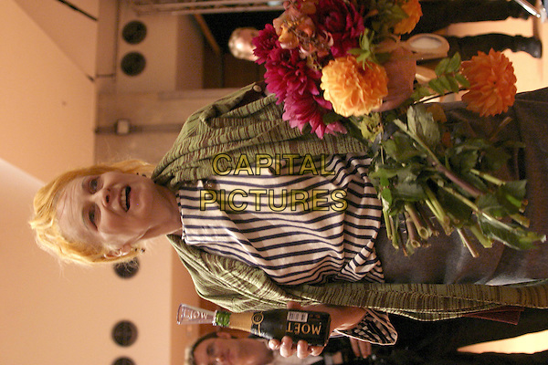 VIVIENNE WESTWOOD .Backstage at the Vivienne Westwood ready to wear Spring/Summer Collection 2005, Paris, France, .October 5th 2004..half length fashion show flowers champagne.Ref: MDS.www.capitalpictures.com.sales@capitalpictures.com.©O.Medias/Capital Pictures .