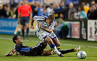 Andre Luiz (left) slide tackles Davy Arnaud (right) in the last seconds of stoppage time. The San Jose Earthquakes defeated the Kansas City Wizards in stoppage time 1-0 at Buck Shaw Stadium in Santa Clara, California on August 22, 2009.