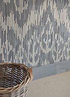 Weft, a handmade jewel glass mosaic shown in Quartz and Pearl, is part of the Ikat Collection by New Ravenna.