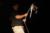 Mike Brookover holds a gar he shot while bowfishing on Aquia Creek in Virginia on June 20, 2013. CREDIT: Lance Rosenfield