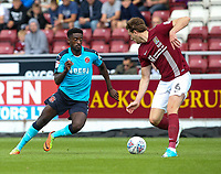 Fleetwood Town's Jordy Hiwula competing with Northampton Town's Ash Taylor <br /> <br /> Photographer Andrew Kearns/CameraSport<br /> <br /> The EFL Sky Bet League One - Northampton Town v Fleetwood Town - Saturday August 12th 2017 - Sixfields Stadium - Northampton<br /> <br /> World Copyright &copy; 2017 CameraSport. All rights reserved. 43 Linden Ave. Countesthorpe. Leicester. England. LE8 5PG - Tel: +44 (0) 116 277 4147 - admin@camerasport.com - www.camerasport.com