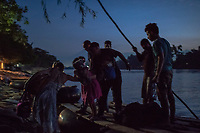HIDALGO, MEXICO - NOVEMBER 07: A little girl holding a &quot;teddy bear&quot; is helped off a raft carrying migrants cross the river Suchiate that intersects the Hidalgo/Tecun Uman Mexican border crossing with Guatemala, early morning under the cover of darkness, on the 7th of November, 2015 in Ciudad Hidalgo, Mexico. <br /> Daniel Berehulak for The New York Times