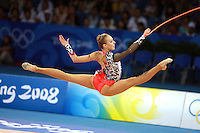 August 23, 2008; Beijing, China; Rhythmic gymnast Inna Zhukova of Belarus split leaps with rope on way to winning silver in the All-Around final at 2008 Beijing Olympics..