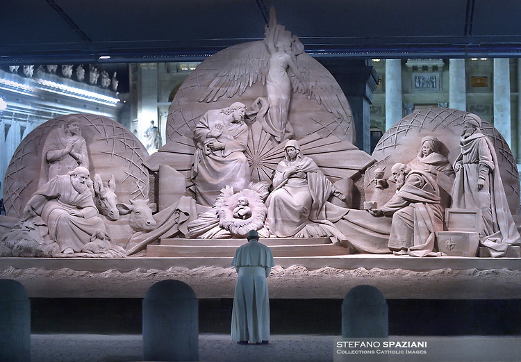"""Pope Francis prays in front of a Nativity scene """"This Nativity was made entirely from the sand of Jesolo beach (Venice), in St Peter's square at the Vatican on December 31, 2018,"""