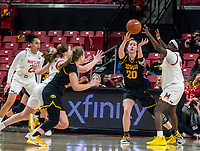 COLLEGE PARK, MD - FEBRUARY 13: Kate Martin #20 of Iowa attempts a pass past Ashley Owusu #15 of Maryland during a game between Iowa and Maryland at Xfinity Center on February 13, 2020 in College Park, Maryland.