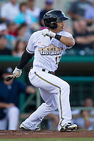 San Antonio Missions outfielder Rico Noel (17) follows through on his swing during the Texas League baseball game against the Midland RockHounds on July 13, 2013 at Nelson Wolff Municipal Stadium in San Antonio, Texas. The Missions defeated the Rock Hounds 5-4. (Andrew Woolley/Four Seam Images)