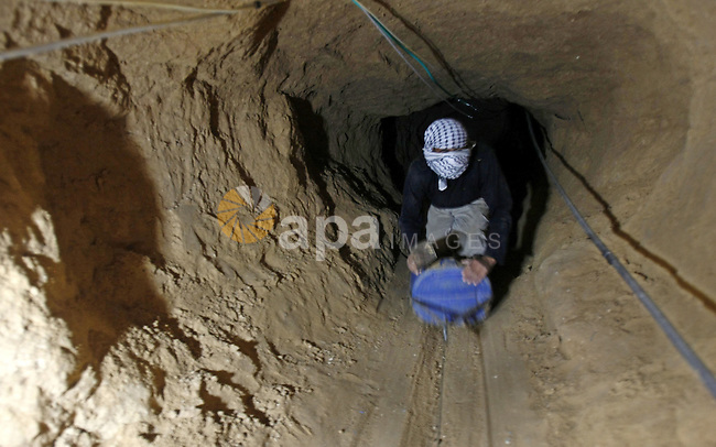 A Palestinians dig a tunnel in the southern Gaza Strip town of Rafah that runs under the Egyptian border on 12 July 2009. A recent study by the Palestinian Centre for Democracy and Conflict Resolution (PCDCR) showed that more than half the 16,000 people working in the tunnels are under 18, as were 30 of the 115 people killed in the tunnels since Israel imposed the blockade two years ago. photo By Abed Rahim Khatib