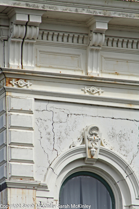 Detail of a building with ornate stone work on G Street in Old Town Eureka in Humboldt County in Northern California.