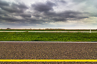 View of flat fields and the roadway along Interstate Highway 45 south of Dallas, Texas.