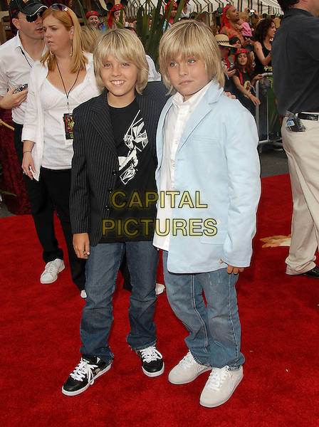 """DYLAN & COLE SPROUSE.attends Disney's """"Pirates of the Caribbean 2: Dead Man's Chest"""" World Premiere held at Disneyland in Anaheim, .Los Angeles, California, USA, June 24th 2006. .full length brothers twins?.Ref: DVS.www.capitalpictures.com.sales@capitalpictures.com.©Debbie VanStory/Capital Pictures"""